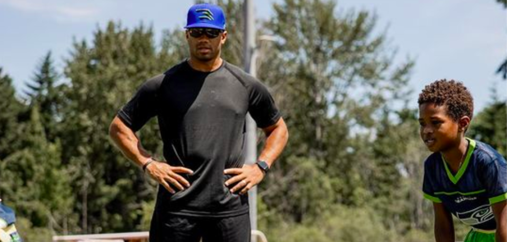'Football Is Back In Seattle': Russell Wilson Coaching Flag Football